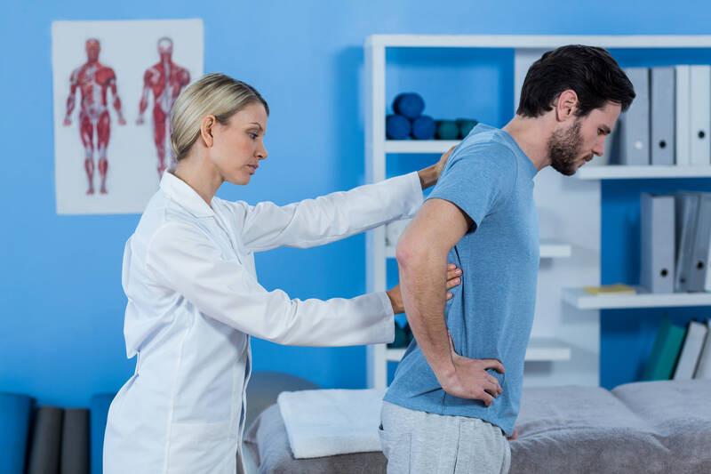 physiotherapist examining back