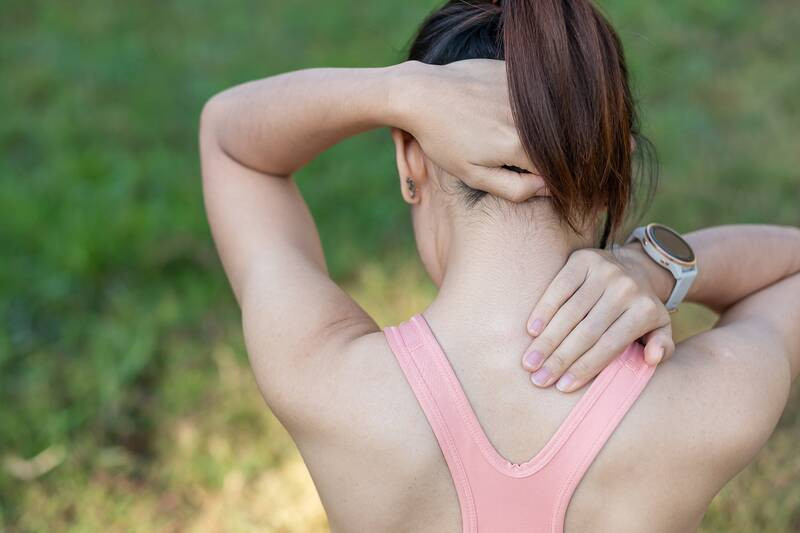 young woman with muscle pain