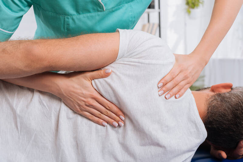 chiropractor alleviating back pain
