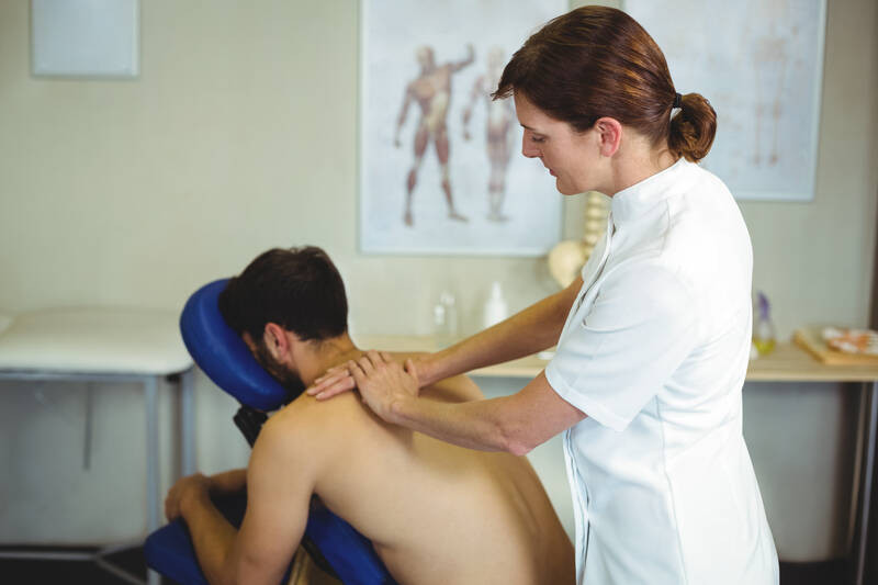 physiotherapist giving massage to patient
