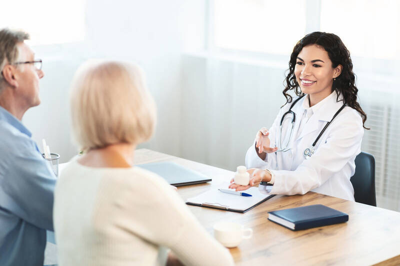 doctor consulting elderly couple