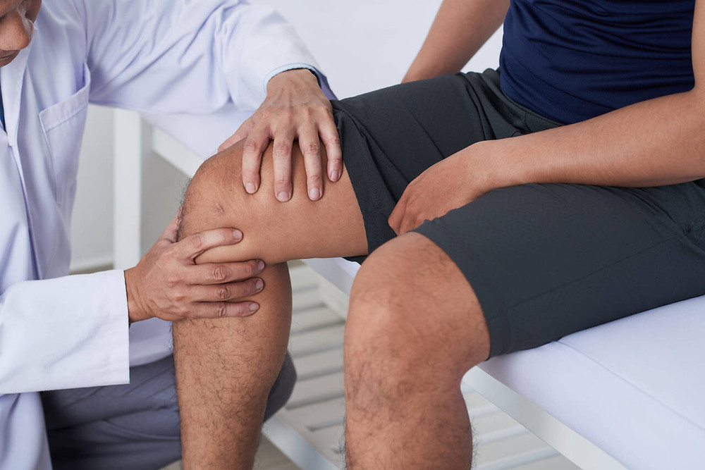 examining knee injury