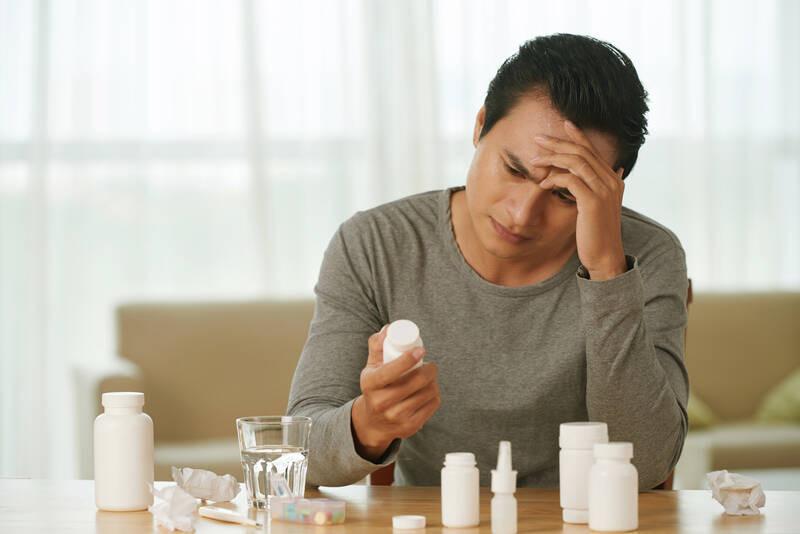 man seeking relief from migraine