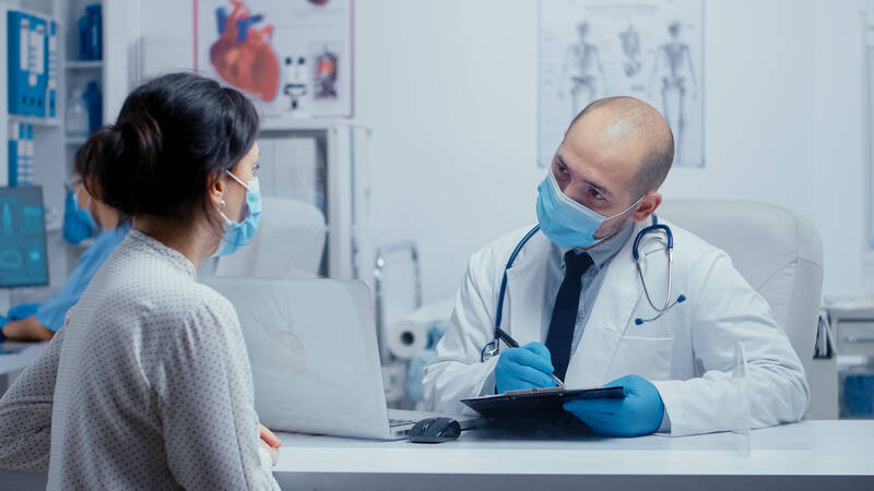 doctor recommending vitamins to patient