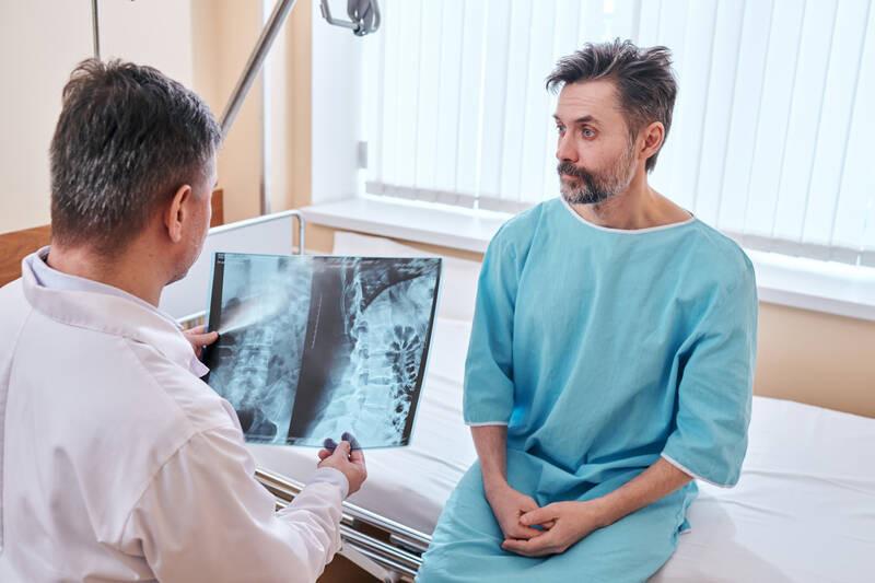 chiropractor examining spine