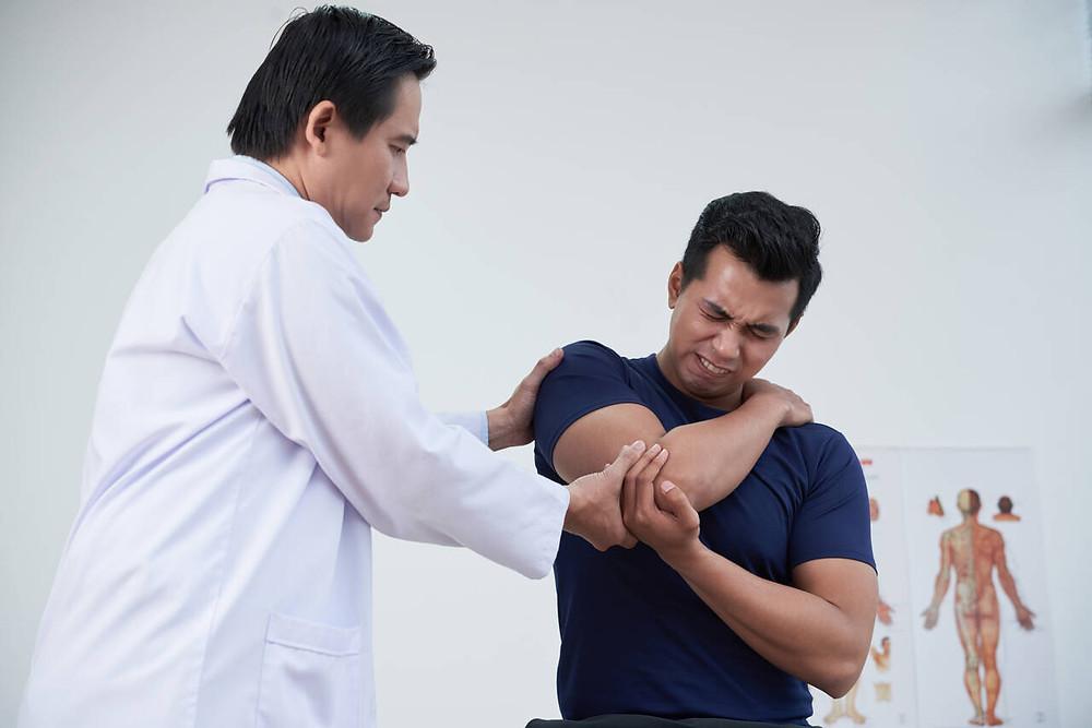 examining shoulder injury