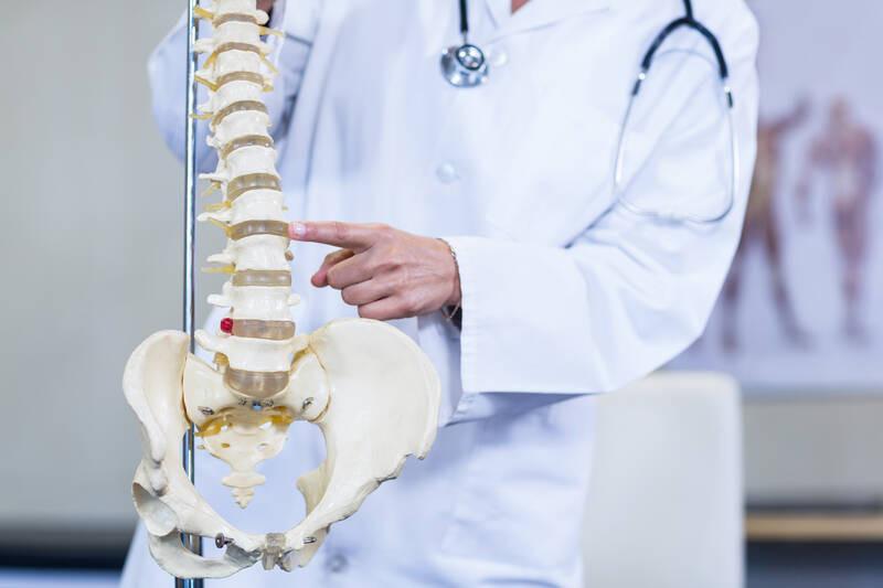 chiropractor explaining spinal stenosis