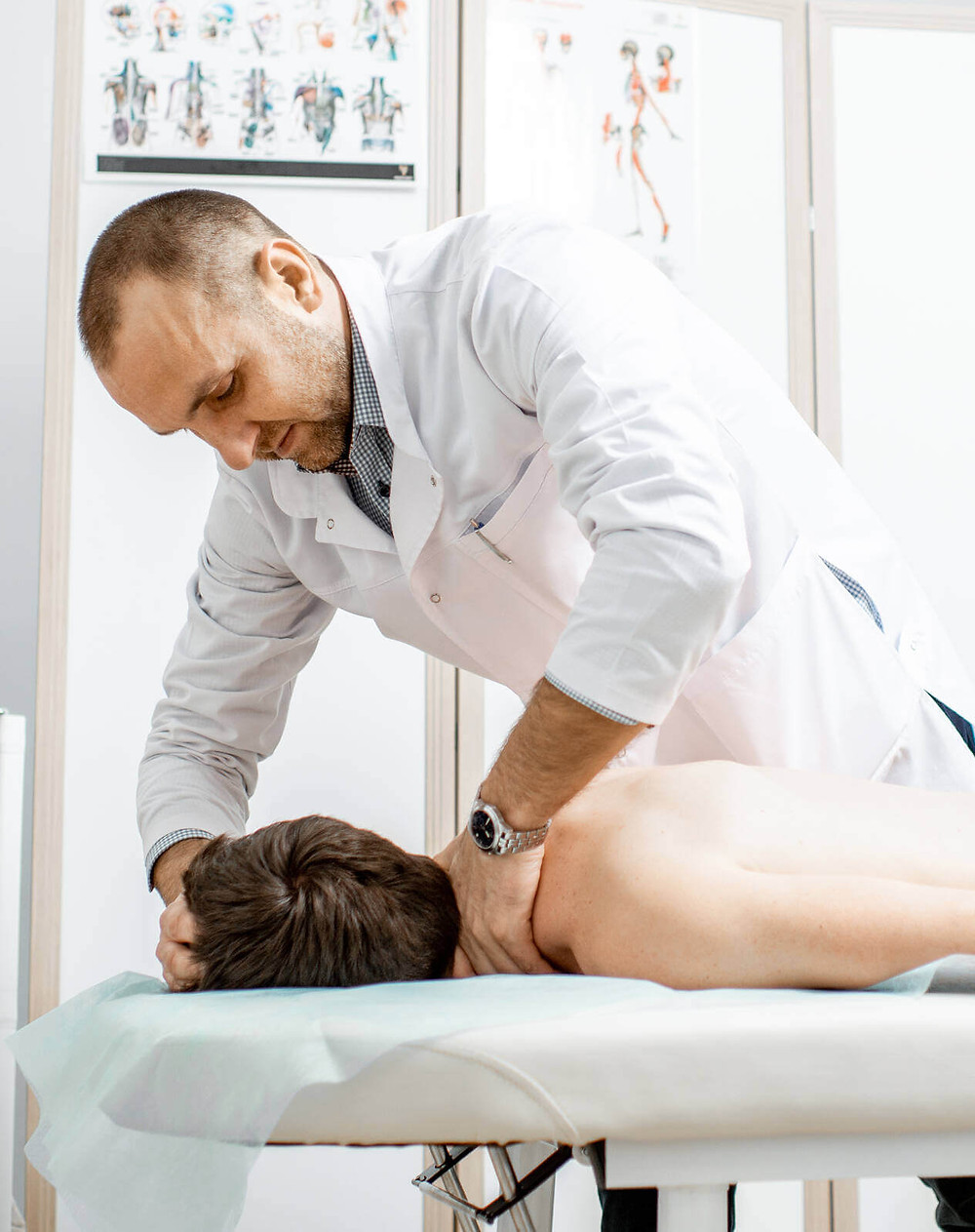 chiropractor doing manual therapy for neck pain relief
