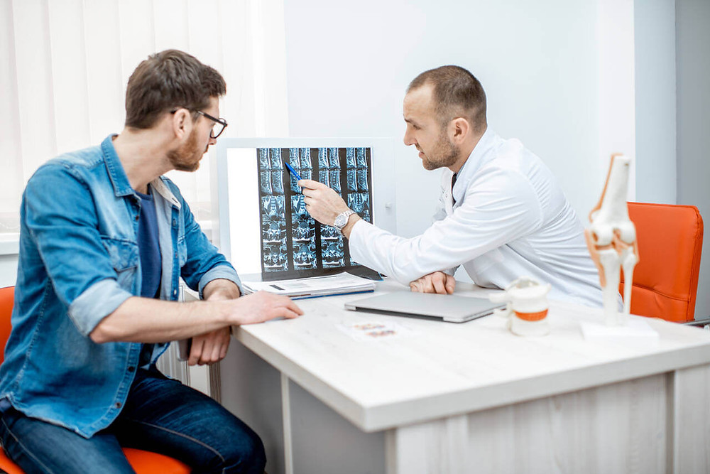 consultation with chiropractor explaining subluxation