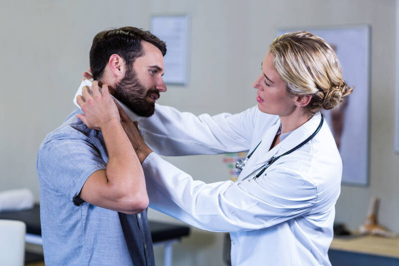 examining patient neck