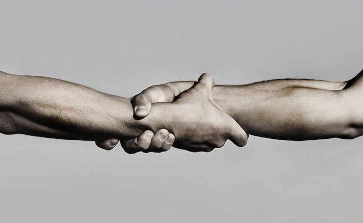 friendly-handshake-friends-greeting-teamwork-friendship-closeup.jpg