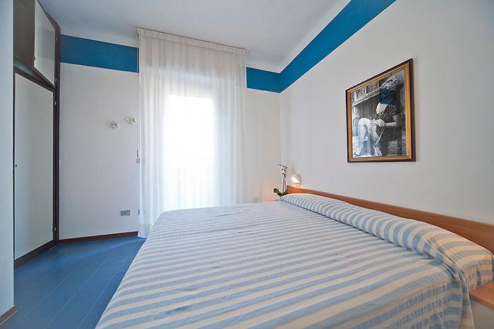 Bilocale attico - Camera da letto