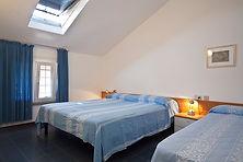 Trilocale attico - Camera da letto