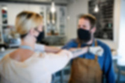 coffee-shop-owners-with-face-masks-elbow