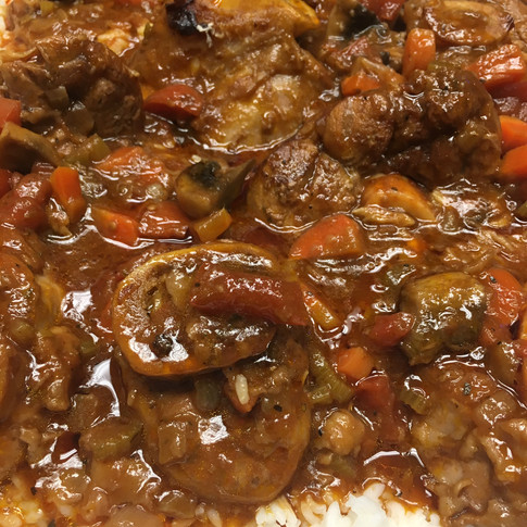 Veal osso bucco over white rice