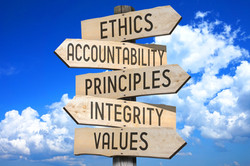 Wooden signpost - code of ethics concept (ethics, accountability, principles, integrity, values)