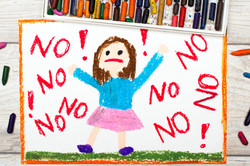 Photo of colorful drawing_ Little girl screaming the word NO