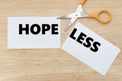 Scissor cut the paper to change from HOPELESS to HOPE