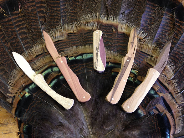 All wood folding pocket knives made by Huck