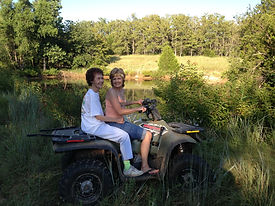 Molly and mom Norma on a quad ride, M&M Ranch, Gene Autry, Oklahoma