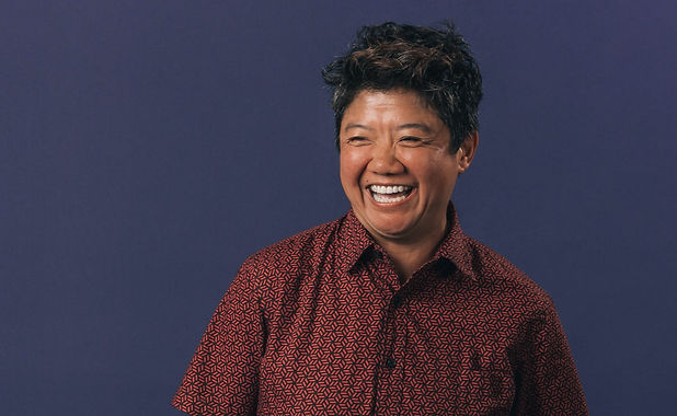 portrait-of-woman-laughing-hand-in-pocke