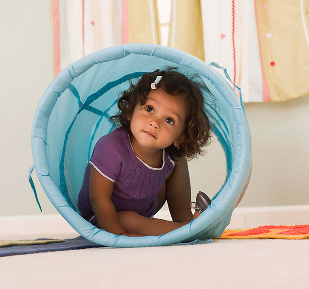 Toddler in play tunnel