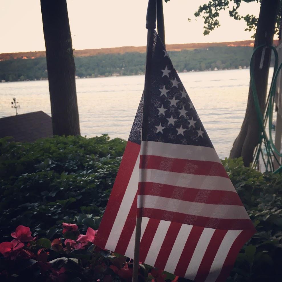 American Flag by Lake