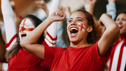 Female soccer fans of England watching a