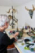 Kate Hanley working in studio on a skull.