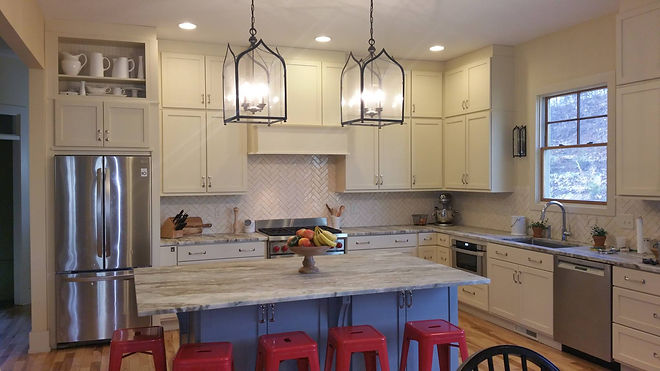 Painted Cabinets with Herringbone backsplash and leathered granite