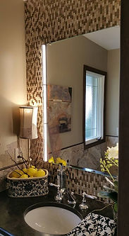 Glass tile with medicine cabinet and bathroom lighting