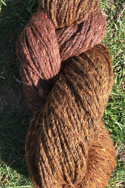 Muted oranges- steam dyed over naturally coloured wool blend.