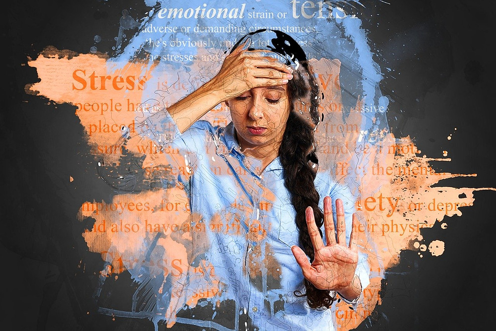 young woman overwhelmed with anxiety and stress
