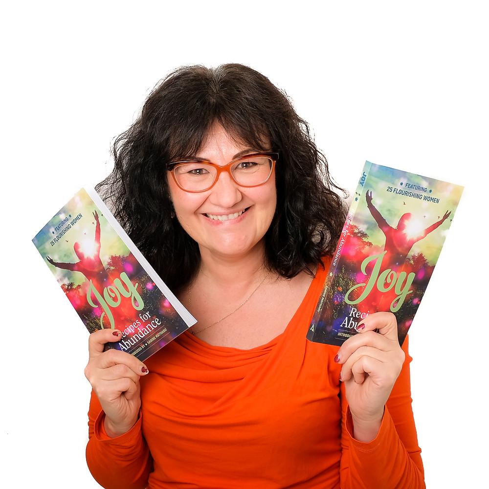 "Asya Barskaya-Lebed with her copy of ""Joy"" book"