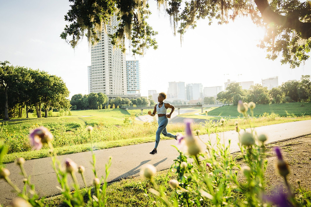 Black woman running in a park