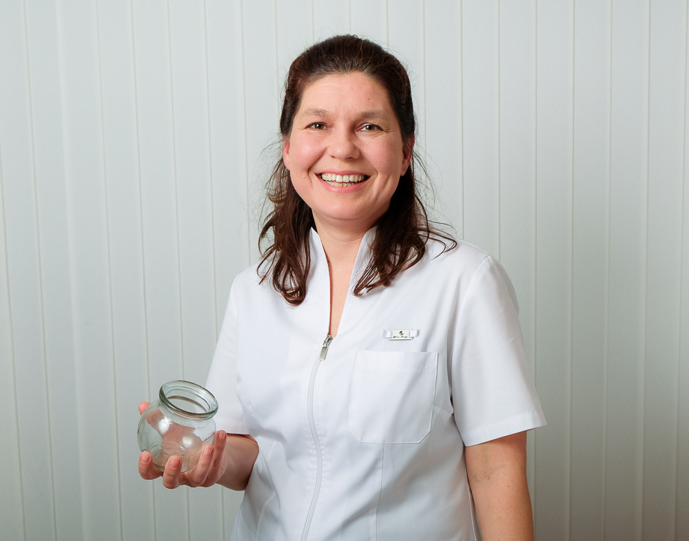 Daria Masterman in her home clinic holding a fire cup