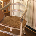 faux distressed chair with accent artwor