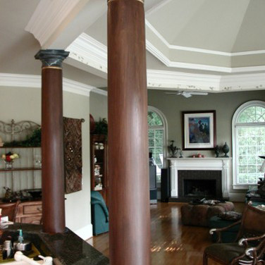 faux wood columns with faux marble capit