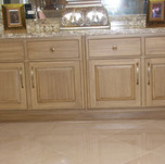 Painted faux wood kitchen cabinet