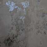 Venetian plaster over multicolored wax
