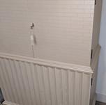 faux wood scalloped cabinet.jpg