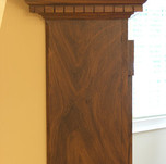 Painted faux wood fireplace mantel