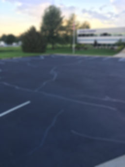 asphalt sealcoat, line striping, rubber crack fill