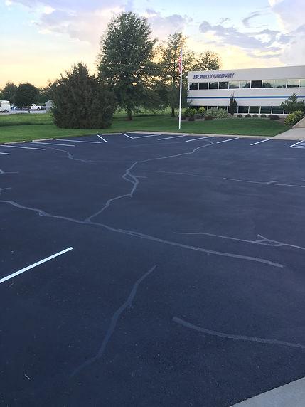 asphalt sealcoat, line striping, rubber crack fill