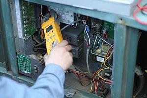 Technician servicing a boiler