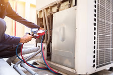 Technician is checking air conditioner ,