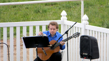 Alan playing guitar at an outdoor wedding in Loveland, Colorado.