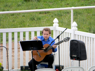 Alan playing guitar at an outdoor wedding in Loveland, Colorado.