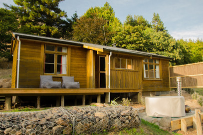 The Cabin layout has a small kitchenette and bathroom in the middle, with one room either side.