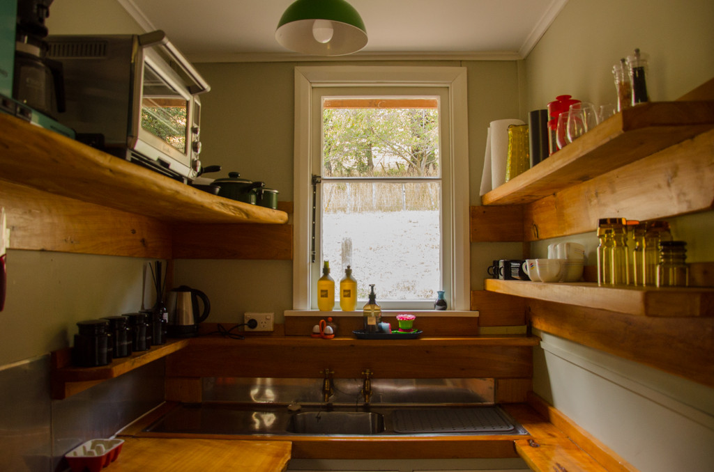The timber kitchenette with gas hob, small fridge and little oven.